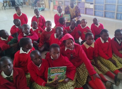 Students in Kenya with their copies of Seeds of Change